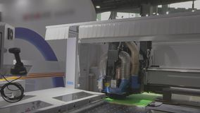 Workflow cnc machine for the procurement of furniture accessories. Modern automated cnc machine.  stock video