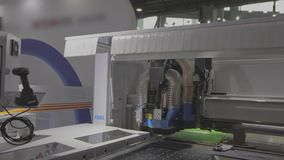 Workflow cnc machine for the procurement of furniture accessories. Modern automated cnc machine.  stock video footage