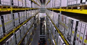 The workflow in the factory warehouse, the workers will do the work in a modern warehouse. Flying between rows in stock.  stock footage