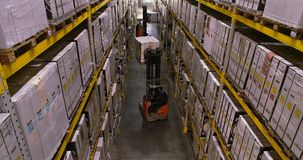 The workflow in the factory warehouse, the workers will do the work in a modern warehouse. Flying between rows in stock.  stock video