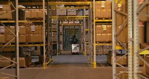 Workflow in a warehouse, active work in a warehouse, forklifts in a warehouse