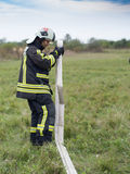 Workflows, hose winding. SZEGED, HUNGARY - October 8, 2015: Regional fire-fighting exercise in the training area with urban and contract firefighters. Practice Royalty Free Stock Photography