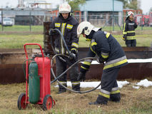 Workflows. Szeged, Algyo, Hungary - October 8, 2015: Regional fire-fighting exercise in the training area with urban and contract firefighters Stock Images