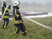 Workflows. SZEGED, HUNGARY - October 8, 2015: Regional fire-fighting exercise in the training area with urban and contract firefighters. Practice is over. The Royalty Free Stock Image