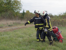 Workflows. SZEGED, HUNGARY - October 8, 2015: Regional fire-fighting exercise in the training area with urban and contract firefighters. Practice is over. The Stock Photos