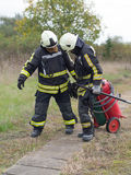 Workflows. SZEGED, HUNGARY - October 8, 2015: Regional fire-fighting exercise in the training area with urban and contract firefighters. Practice is over. The Royalty Free Stock Images