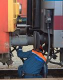 Workin' on the Railroad. A man connects a locomotive to a passenger car in Hungary Stock Photography