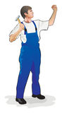 Working. The man the worker in dark blue overalls and with a hammer carries out repair work Royalty Free Stock Photo