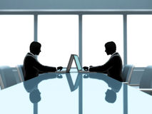 Working. Two business men,  working on a laptop in the meeting room Royalty Free Stock Photo