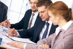 Working. Group of business people working on some documents at the office Royalty Free Stock Images