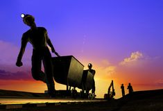 Working. Silhouettes of workers in the night sky Stock Images