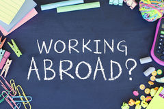 Working Abroad. Business concept text on chalkboard background Stock Photos