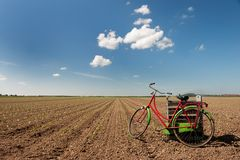 Working in agriculture fields. With bicycle and empty crates Stock Photography