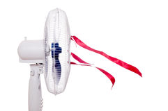 Working air fan with red ribbons isolated on white. Air movement Stock Image