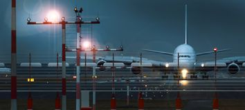 Working airport beacons with starting airplane in the evening. A working airport beacons with starting airplane in the evening Stock Images