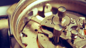Working alarm clock mechanism. Closeup view of working ringing mechanism of an old alarm clock in real time speed stock footage