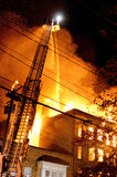Building on fire. Total loss of an apartment building Stock Image
