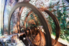 Working ancient millwheel blurred by rotation Stock Photos