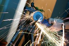 Working with angle grinder. Angle grinder , reconstruction of home concept , plumbing concept Royalty Free Stock Photo