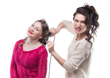 Working angry hairstylist and woman Royalty Free Stock Images