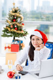 Working on annual report. Business lady working on annual report on Christmas day Royalty Free Stock Image