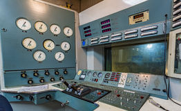 Working area in an aircraft factory. Operating panel with instrumentation and control levers Stock Photography