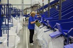 Working around conveyor Royalty Free Stock Photos