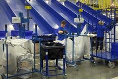Working around conveyor Stock Photo