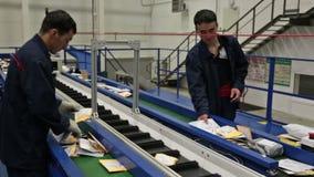 Working around conveyor stock video footage