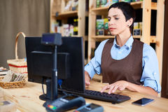 Working as cashier Royalty Free Stock Photos