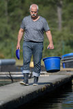 Working as fish harvester. Working as a fish harvester stock photo