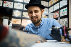 Working as tattooer Stock Photography