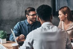Working as a team. Group of young confident business people disc Stock Image