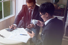 Working as a team of professionals on a project in the office Royalty Free Stock Image