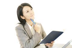 Working Asian business woman. Asian business woman sitting at desk working on laptop Stock Photography