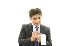 Working Asian businessman Stock Image
