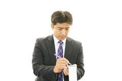 Working Asian businessman Stock Photos