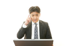 Working Asian businessman Royalty Free Stock Photos