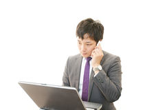 Working Asian businessman Stock Photo
