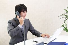 Working Asian businessman. At his office stock photo