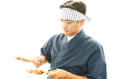 Working Asian cook Stock Images