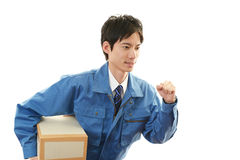 Working Asian courier Royalty Free Stock Photos