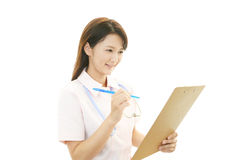 Working Asian female nurse Royalty Free Stock Photography