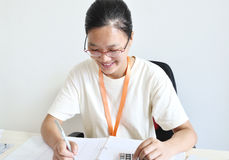 Working asian woman Royalty Free Stock Images