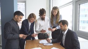 Working atmosphere in the office. Group of business people discussing business issues. Working atmosphere in the office. Group of business people discussing Royalty Free Stock Image