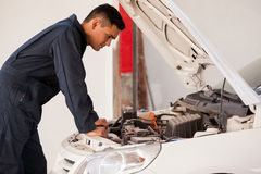 Working at an auto shop Royalty Free Stock Image