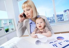 Working with baby Royalty Free Stock Photo