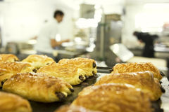 Working in a bakery. Focus on pain au chocolat Stock Photography