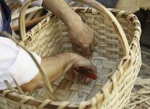 Working a basket. Detail of a craftsman making a straw basket Stock Image
