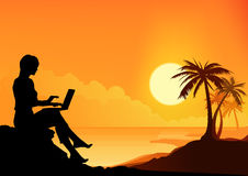 Working Beach Girl. Girl working on a laptop with a beach in background Stock Photography